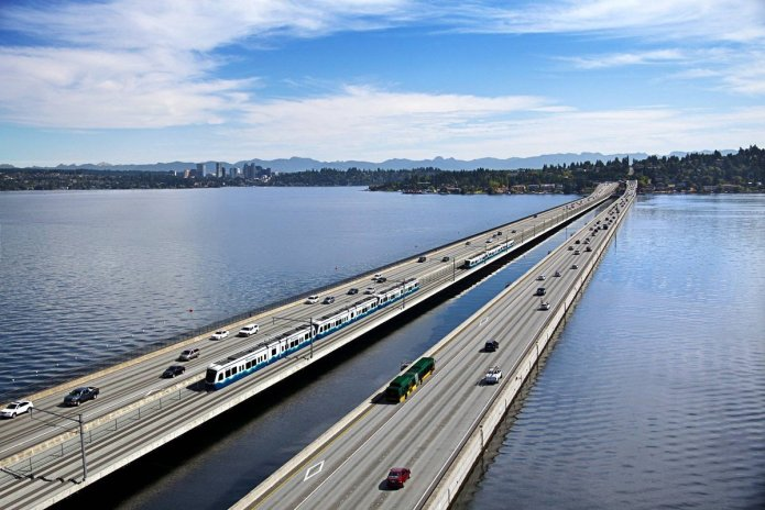 Rendering of East Link light rail trains operating on the I-90 floating bridge. (Sound Transit)