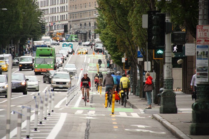 The Second Avenue protected bike lane was extended to Denny Way in 2018. Congestion pricing could fund more walking and biking infrastructure while making it more pleasant to use by lowering car traffic.(SDOT)