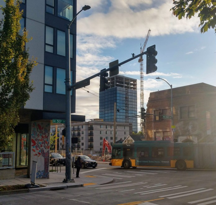The M Tower, the first highrise out of the gates after the U District was rezoned in 2017, rises in the background of this shot of The Ave at NE 50th St. (Photo by Doug Trumm)