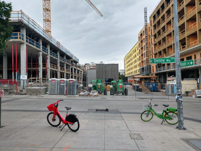 A JUMP bike and a Lime bike site outside Capitol Hill Station. Bikeshare can be a last mile solution connecting transit riders to their final destinations, but it needs to be dependable in every season. (Photo by Doug Trumm)