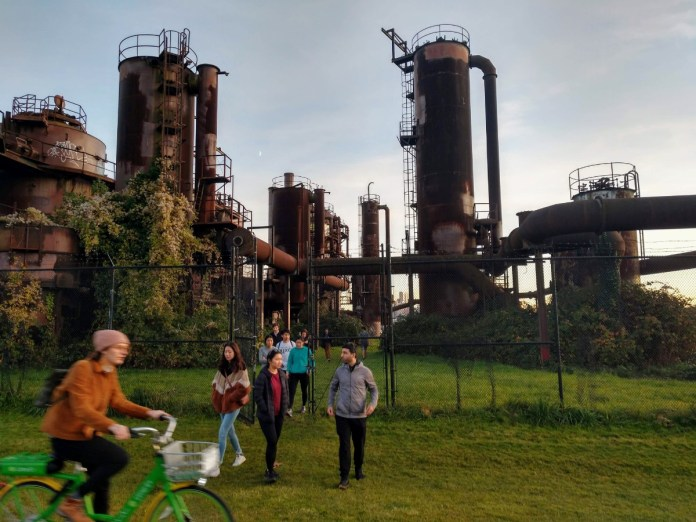 Gas Works Park is a great place to ride a bike. If you'll luckily like these folks, you're find the gate open to wander around the old plant. (Photo by author)