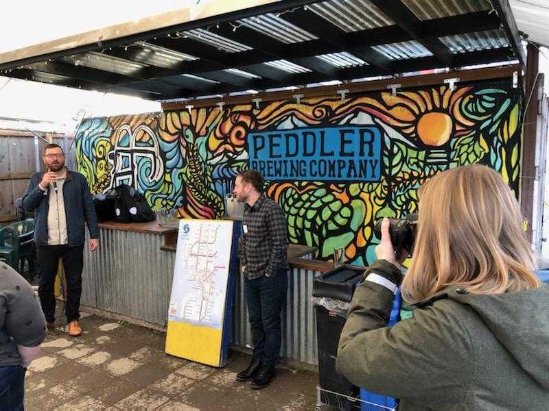 Owen and address fundraiser attendees at Peddler Brewing. (Photo by Rian Watt)