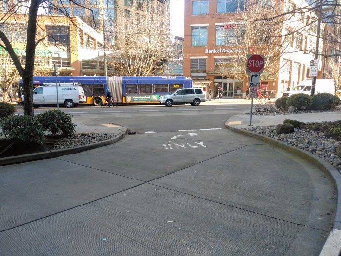 An extended transit stop would bridge either sides of 9th Avenue with a raised crosswalk to communicate the space as for pedestrians. (Photo by the author)