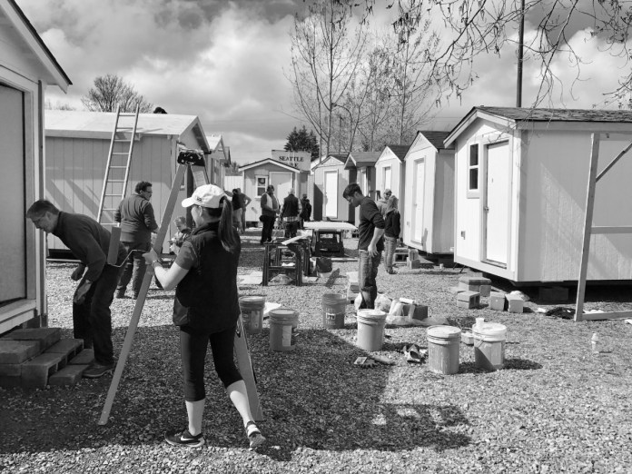 Volunteers building and painting tiny houses at Georgetown Village in March of 2017. (Photo by the author)