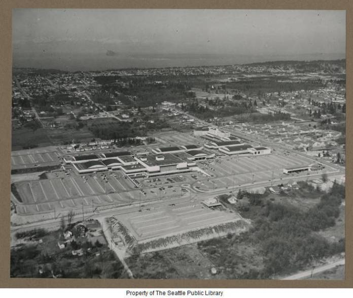 An early aerial view of the 60 acre Northgate Shopping Center. The original design included 3,500 parking spaces. After the completion of Interstate 5 in 1965, about 50,000 cars visited Northgate daily during its commercial peak. (Credit: Seattle Public Library Special Collections)