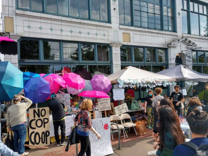 """""""No cop co-op"""" signs at the CHOP. (Photo by author)"""