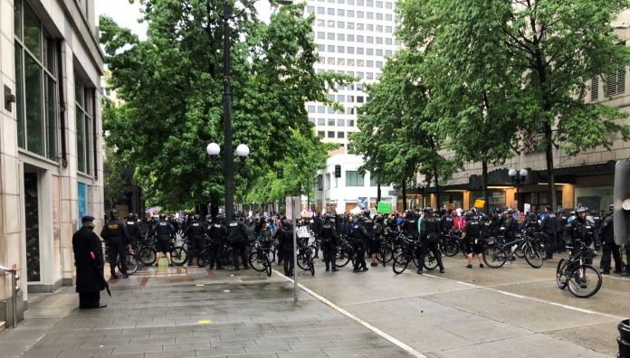 A large contingent of police barricaded 4th Avenue with their bicycles, blocking a route out of Westlake Park. (Photo by Robert Cruikshank)