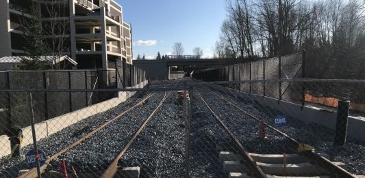 Light rail tracks near a Bellevue parking garage. Sound Transit's expansion timelines are under financial stress due to the Covid recession. (Photo by Stephen Fesler)