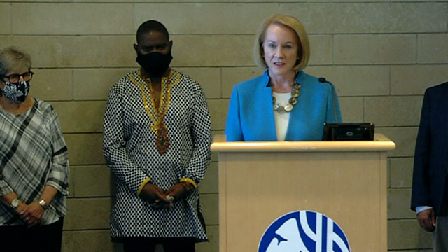 Mayor Jenny Durkan flanked by Andre Taylor at Monday press conference on the CHOP shooting. (Seattle Channel)