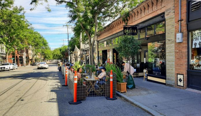 Patrons eat in a new parklet patio at Gracia in Ballard. (Photo by Doug Trumm)