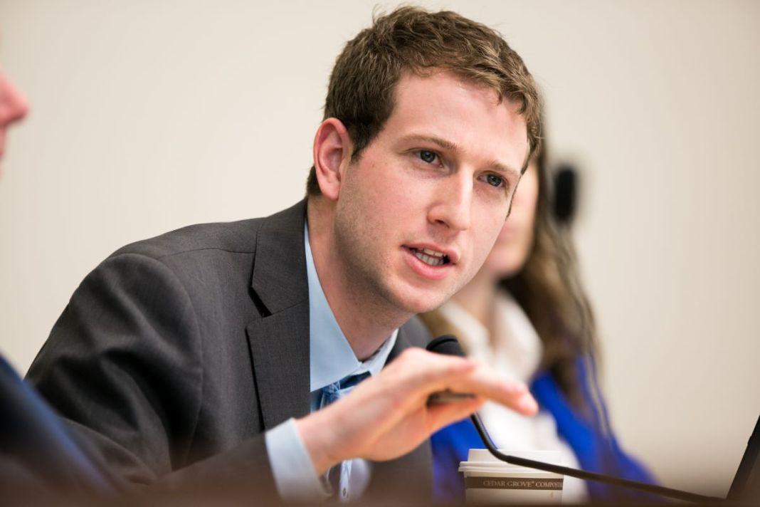 Picture of Joe Fitzgibbon making a hand gesture at a hearing. (Credit: Washington State Legislature)