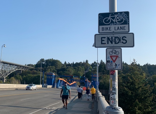 Cyclists are forced to move to the sidewalk in order to cross the Fremont Bridge. With widths that barely exceed six feet at key points, the sidewalks are not equipped to handle large numbers of cyclists and pedestrians. (Photo by author)