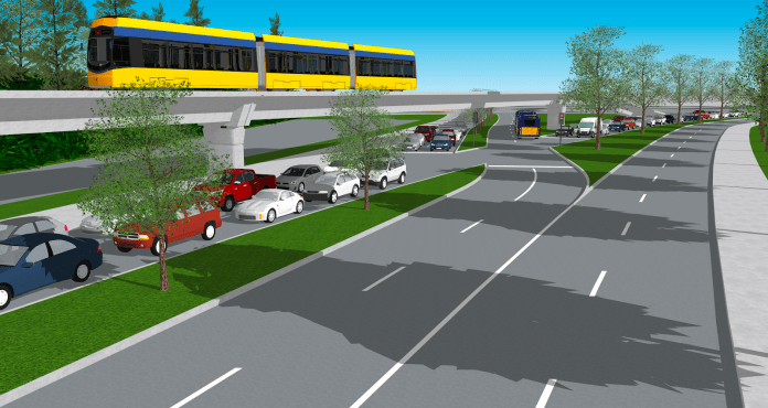 The elevated yellow tram makes it pass over Montlake Boulevard near the stadium.