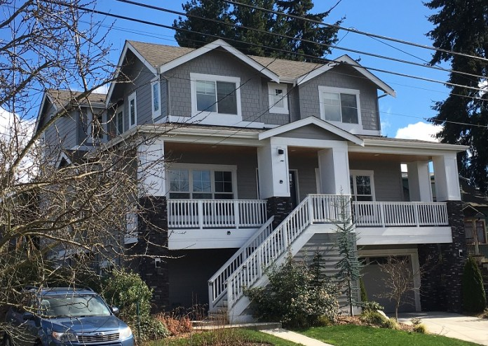 A very large and boxy three-story house in Wallingford.