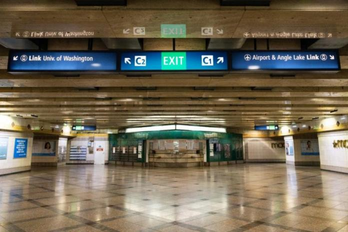 Mockup of what new overhead wayfinding signs will look like at Westlake Station. (Sound Transit)