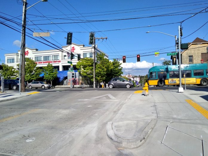 Curb extensions at S King St and 12th Ave S are intended to bring the bike lane onto the sidewalk on either side of the intersection. (Photo by the author)