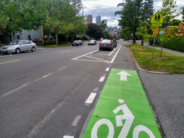 The new protected bike lane along E Union St took shape in May. (Photo by the author)