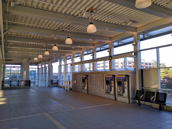 Station mezzanine with ticket vending machines and seating