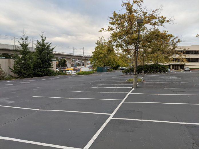 A photo of a parking lot close to the Northgate light rail station