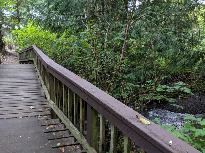 A photo of a bridge over Thornton Creek in the Beaver Pond Natural Area