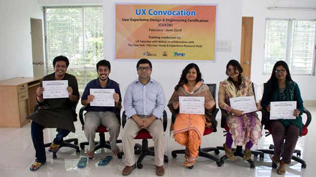 Wahid sitting with UX students on their convocation at Therap
