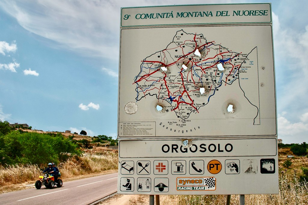Shot up road sign om the outskirts of Orgosolo (Shutterstock)