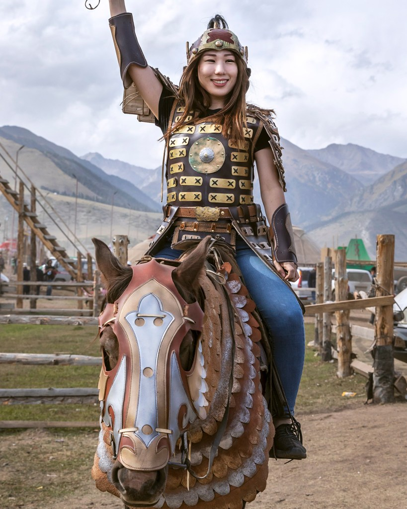 Girl in Mongol warrior outfit during World Nomad Games 2018 (Shutterstock)
