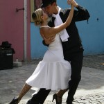 A couple dance the tango on the streets of Buenos Aires (Adobe Stock)