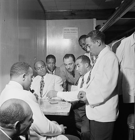 Fellow players check 'Scratchy's' hand at the 'Aquarius Club' while he's smoking in the john (photo by William P. Gottlieb)