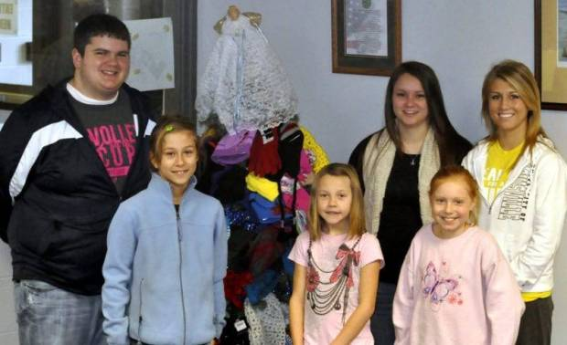 2012 STUDENT COUNCIL MITTEN TREE … Students and staff at Edon Northwest Local Schools recently completed the annual Angel Tree project by collecting cold-weather apparel for local children.  Gathered around the tree, decorated with nearly one hundred fifty items are front, from left, Brianna Heinze, Tatum Workman, Maicie Blade and back, from left, David Headley, Mariah Hantz and Sydney Stoll.  All hats, mittens, scarves and gloves were donated to Edon Area Ministerial Association for its A Caring Christmas ministry.