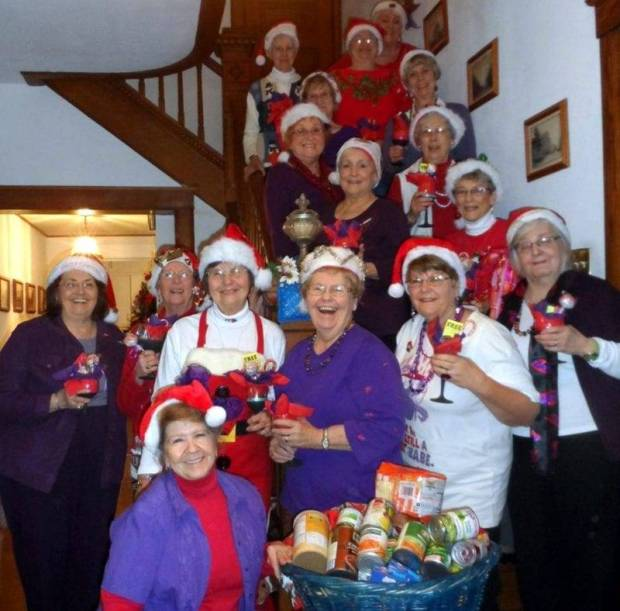 RED HATTERS ... Rouge Dames collect food for the food pantry:  (row 1)  Marty Brace, (row 2)  Rosanne Fisher, Nina Fackler, Marillyn Scott, Charlene Williams (Queen Mother), Cheryl Gallagher (guest), Greta Crilley, (row3)  Shirley Harding, Delores Dennis, row 4)  Mary Jane Stevens, Dorothy Briner, (row 5)  Jan Clark, Jane Kwader, (row 6)  Carolyn Figgins, Jean Hicks and JoAnne Bandeen