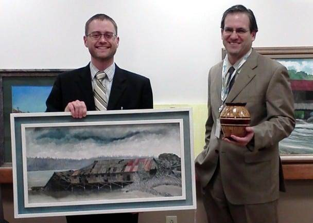 NEW ART SHOWCASED ... Chris Kannel (left), President of the Williams County Arts Council delivers seven new pieces of art to Phil Ennen, CEO of CHWC.