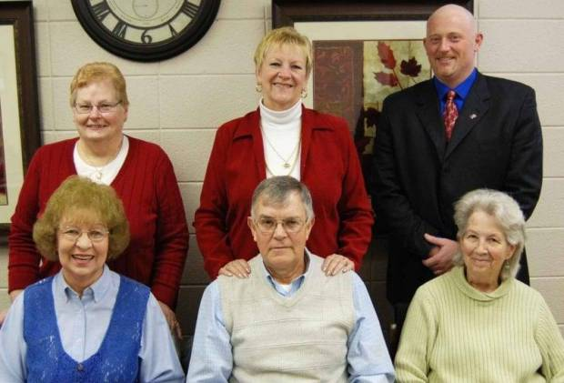 The Quadco Administrative Board reorganized for 2013 prior to their regular meeting on January 22 and retained their officers from the previous year. Barb Heer of Stryker will serve again as President, Jean Lightle-Jackman of Defiance will continue as Vice President and Gary Burr of Bryan remains the Secretary. Board members shown in the photo seated from left to right are Jean Lightle Jackman, Tom Eggers of Ridgeville Corners, and Barb Heer. Standing from left to right are Ruth Ann Osborn of Bryan, Tootie Bockelman of Napoleon and Gary Burr. Herb Gurwell from Delta and Barbara Grant from Sherwood are missing from the photo.