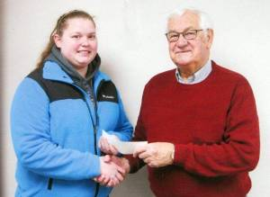 AWARDED ... Rebecca Rush receiving the scholarship from Lowell Beaverson.