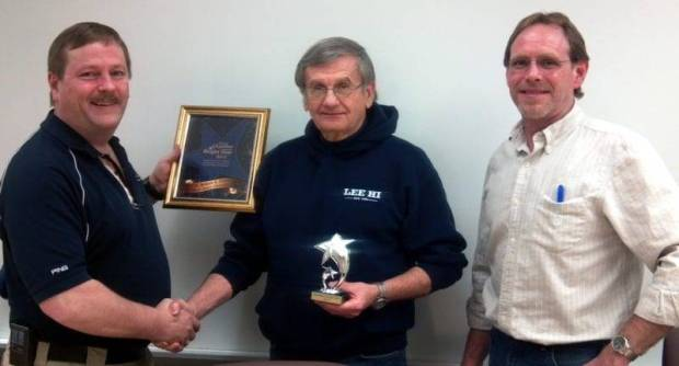 AWARD ... Pictured presenting the award (left to right) Alan Bennett, Chamber President Dr. Bob Smith, Board Member and Superintendent, Dan Woodring, Chamber Director
