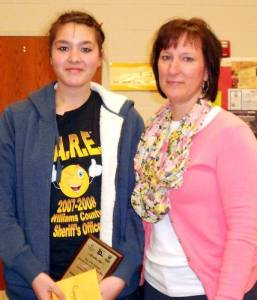 Meili Leung, winner of the Montpelier Spelling Bee, receiving a $100 prize from Barbara Turner.  The prize was given in memory of Denver Bechtol.