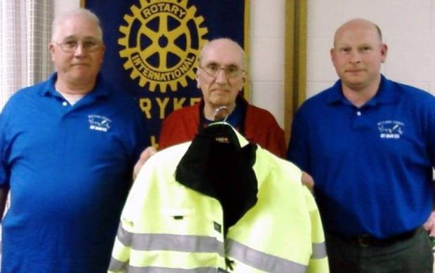 ROTARY ... The men spoke as the guest of Dean Beamont, Stryker Rotarian. Bob Lee on the left is pictured with Dean Beamont, center, and James Hankins, right. They are displaying the yellow reflective jacket the group would like to be able to provide.