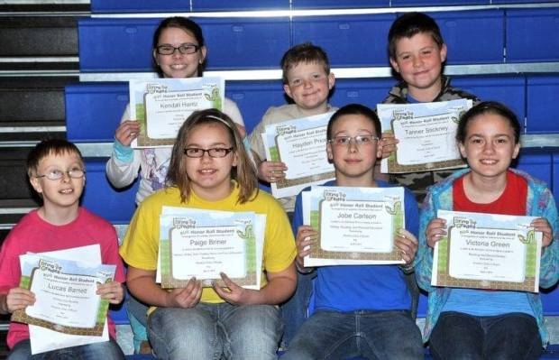 FOURTH GRADE BUG AWARDS … Fourth Graders honored for bringing up their grades during the 2012-2013 Third Nine Week Grading Period in Mrs. Becker's and Mrs. Kiess' Fourth Grade classes were:  Front row, from left, Lucas Barnett, Paige Briner, Jobe Carlson and Victoria Green.  Back row, from left, Kendall Hantz, Hayden Price and Tanner Stickney.  Not pictured ~ Nevaya Deck.
