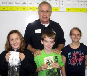 In this picture from North Central are: Lynzi Laub, Ryan Nafziger and Aleegan Kelly. The students are standing with Pioneer Lions Club Member Courtney Earhart.