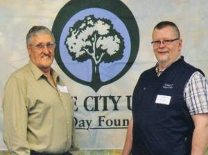 West Unity Council Member Rich Merillat and Village Administrator Ric Beals accepted the 2013 Tree City USA Award on behalf of the village.