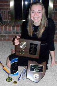 ACHIEVMENTS ... Hilltop High School junior, Emily Maneval displays some of her recent awards for her science project, defining what acne medications would kill off non-pathogenic forms of bacteria. Her project helped her place in the Top Four in the regional science fair held in March. She is invited to attend as an observer at the Intel International Science and Engineering Fair event held in Phoenix, Arizona from May 12-17.  Some of her recent awards include the Apothecary Medicine Award plaque and $100, and an U.S. Public Health Service Award medallion.