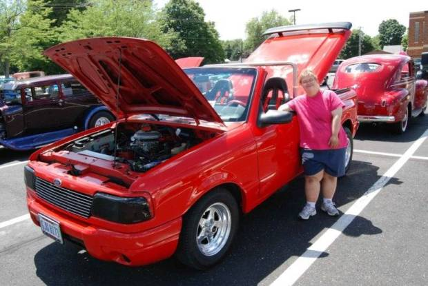 Amber Pursel looks over a custom Ford Ranger at the QRC 3rd Annual Cruise-In held at the Stryker school parking lot on July 31. People from QRC and the community got to see all kinds of classic cars, trucks, hotrods and motorcycles at the free show.