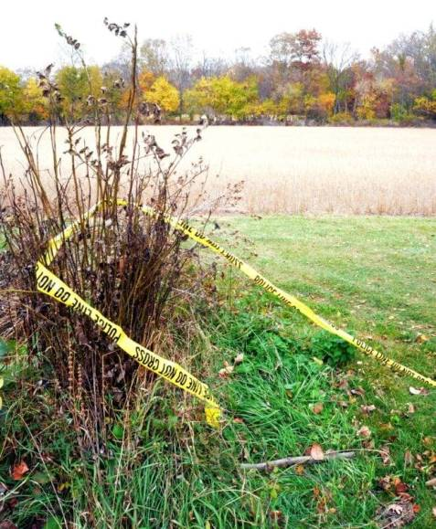 Police tape is still at the scene of the investigation over the weekend.  Photo by Sarah Yeakey, Staff