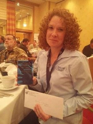 Amanda Podach accepting award