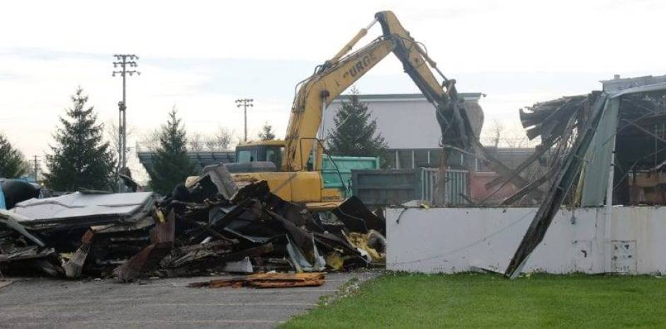 Demolition of the former bus garage on Fernwood Street began on May 3, after being rendered unusable after a 2014 fire.