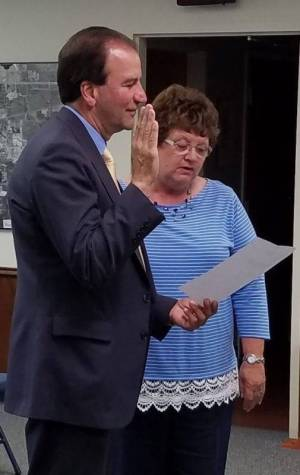Kathy Kreuz is sworn in by Law Director Alan Lehenbauer to fill vacant council seat.