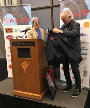 David Amram tries on his Village Trip tour jacket (Gabe Herman)