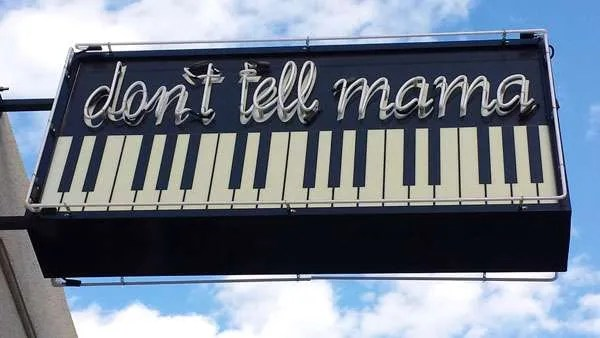 Don't Tell Mama outdoor neon sign