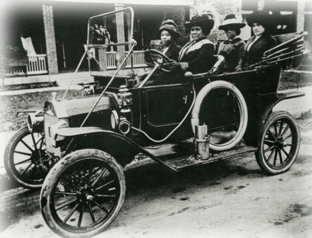 Madam Walker and several friends in her automobile .Source