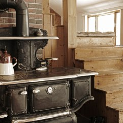 Cast Iron Kitchen Stove Inside Cabinet Organizers Grandma S Wood Stoves Were The Heart Of Every Home An Old Cook Is Perfect Accessory In This Rustic Look Modern Note Waiting To Be Heated Up